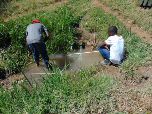 The Water Project:  Artisan Taking Site Measurements