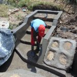 The Water Project: Mukhuyu Community, Chisombe Spring -  Finishing Stair Plaster