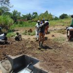 The Water Project: Mukhuyu Community, Chisombe Spring -  Soil Backfilling