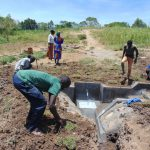 The Water Project: Mukhuyu Community, Chisombe Spring -  Grass Planting And Site Leveling