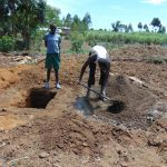 The Water Project: Mukhuyu Community, Chisombe Spring -  Slab Construction