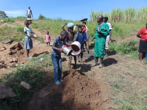 The Water Project:  Community Contribution Children Bring Sand