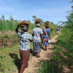 The Water Project: Mukhuyu Community, Chisombe Spring -  Community Contribution Women Carrying Grass