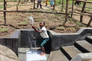 The Water Project:  A Girl Splashing Water