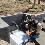 The Water Project: Mukhuyu Community, Chisombe Spring -  Boy Celebrating