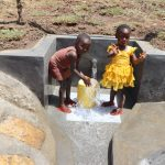 The Water Project: Mukhuyu Community, Chisombe Spring -  Collecting Water