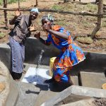 The Water Project: Mukhuyu Community, Chisombe Spring -  Women Celebrate Water
