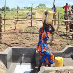 The Water Project: Mukhuyu Community, Chisombe Spring -  Community Member Carrying Water