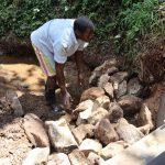 The Water Project: Harambee Community, Elijah Kwalanda Spring -  Large Stone Backfilling