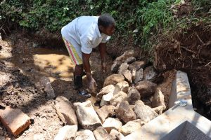 The Water Project:  Large Stone Backfilling