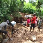 The Water Project: Harambee Community, Elijah Kwalanda Spring -  Community Helps With Backfilling