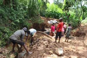 The Water Project:  Community Helps With Backfilling