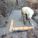 The Water Project: Harambee Community, Elijah Kwalanda Spring -  Brick Setting