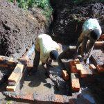 The Water Project: Harambee Community, Elijah Kwalanda Spring -  Wall Construction