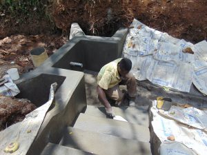 The Water Project:  Plastering Stairs
