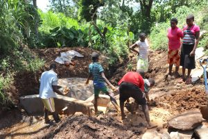 The Water Project:  Community Members Helping With Clay Works