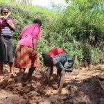 The Water Project: Harambee Community, Elijah Kwalanda Spring -  Mixing Of Clay Soil With Water