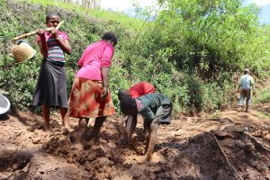 The Water Project:  Mixing Of Clay Soil With Water