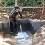 The Water Project: Harambee Community, Elijah Kwalanda Spring -  Chair Keri Takes A Fresh Drink