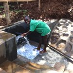 The Water Project: Harambee Community, Elijah Kwalanda Spring -  A Young Boy Having A Touch Of Water