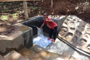 The Water Project:  A Young Girl Touching Water