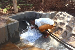 The Water Project:  Community Member Enjoying Water