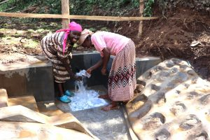 The Water Project:  Community Members Feeling The Coldness Of Water