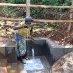 The Water Project: Harambee Community, Elijah Kwalanda Spring -  Water User Drinking Water