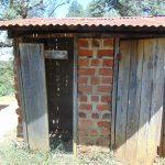 The Water Project: Ivakale Primary School & Community - Rain Tank 2 -  Latrine Block With Broken Door