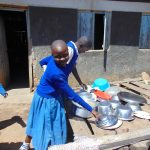 The Water Project: Ivakale Primary School & Community - Rain Tank 2 -  Reaching For A Bowl On The Dishrack