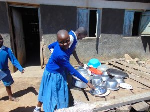 The Water Project:  Reaching For A Bowl On The Dishrack