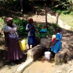 The Water Project: Ivakale Primary School & Community - Rain Tank 2 -  Waiting For Her Bucket To Fill