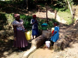 The Water Project:  Waiting For Her Bucket To Fill