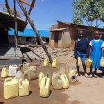 The Water Project: Ivakale Primary School & Community - Rain Tank 2 -  Pupils With Water Containers At Central Dropoff Point