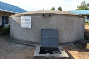 The Water Project:  Completed Rain Tank With Water Flowing
