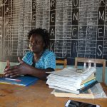 The Water Project: Ivakale Primary School & Community - Rain Tank 2 -  Teacher At Her Desk In The Staff Room