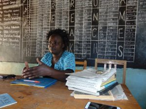 The Water Project:  Teacher At Her Desk In The Staff Room