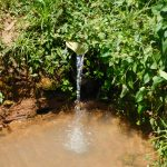 The Water Project: Mukhweso Community, Shemema Spring -  Improvised Iron Sheet Discharge Pipe