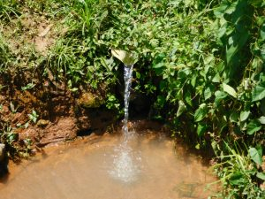 The Water Project:  Improvised Iron Sheet Discharge Pipe