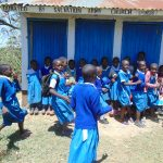 The Water Project: Ivakale Primary School & Community - Rain Tank 2 -  Running To Get In Line For The Bathroom
