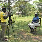 The Water Project: Shihingo Community, Mulambala Spring -  Camera Operator Allan Amadaro Talks With Margret