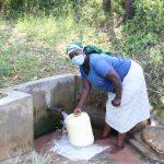 The Water Project: Shihingo Community, Mulambala Spring -  Fetching Water From Mulambala Spring