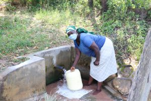 The Water Project:  Fetching Water From Mulambala Spring