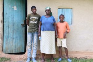 The Water Project:  Margaret With Her Sons In Front Of Their House