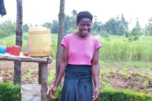 The Water Project:  A Light Moment While Letting Her Hands Air Dry