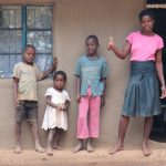 The Water Project: Burachu B Community, Shitende Spring -  Magdalene With Her Family Outside Her House
