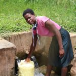The Water Project: Burachu B Community, Shitende Spring -  Magdalene Fetching Water For Cooking