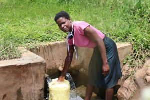 The Water Project:  Magdalene Fetching Water For Cooking