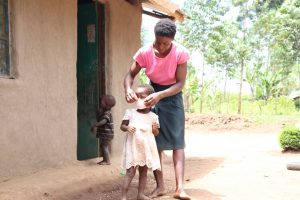 The Water Project:  Magdalene Helping Her Daughter Lilly Put On Her Mask
