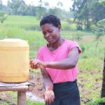 The Water Project: Burachu B Community, Shitende Spring -  Magdalene Washing Her Hands At Home